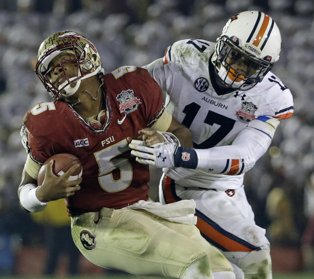 Auburn's Kris Frost tackles Florida State's Jameis Winston on a run during the second half of the NCAA BCS National Championship college football game Monday, Jan. 6, 2014, in Pasadena, Calif. (AP Photo/David J. Phillip)