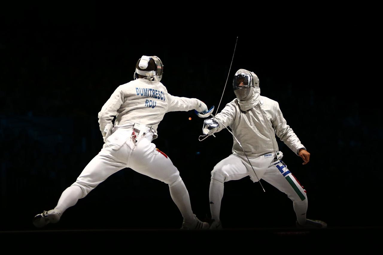 LONDON, ENGLAND - JULY 29:  Nikolay Kovalev (R) of Russia competes against Rares Dumitrescu of Romania in the Men's Sabre Individual on Day 2 of the London 2012 Olympic Games at ExCeL on July 29, 2012 in London, England.  (Photo by Quinn Rooney/Getty Images)