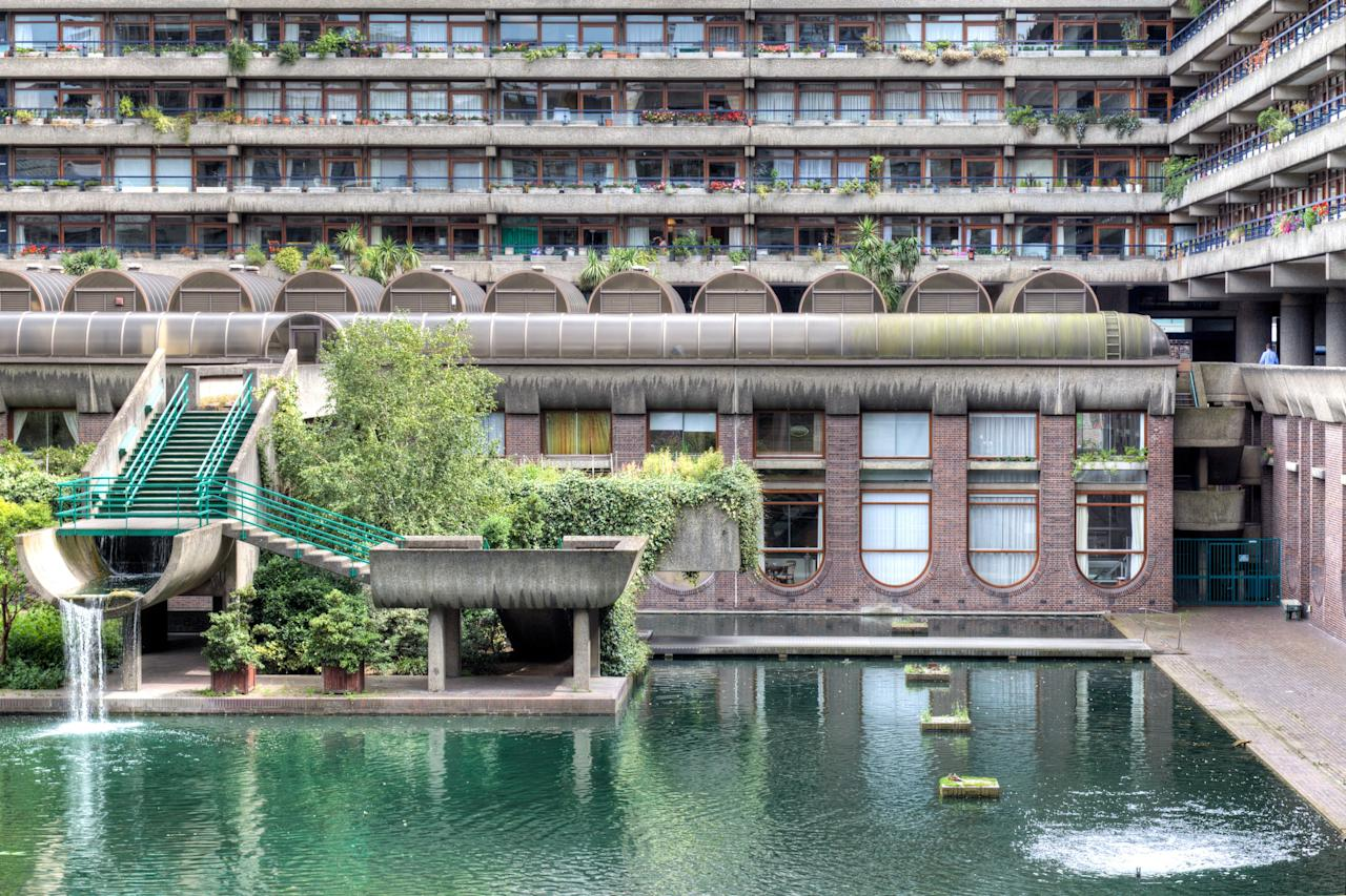 A brilliant example of Brutalist architecture, the Barbican Estate is a mixed-use complex designed in the 1950s by architects Chamberlin, Powell, and Bon. Located on a WWII bomb site in London, it includes three residential towers, known as Cromwell, Shakespeare, and Lauderdale, as well as 13 seven-story residential terrace blocks, all positioned around a car-free public plazas that include multiple greens and a lake. The estate, designed to function as its own community, includes schools, a library, a museum, and an arts venue known as Barbican Centre. Opened in 1986, the complex is still very much in use today with highly sought-after apartments, and though it's maligned by those who loathe Brutalism, it's regarded by most as a shining example of city living at its best.