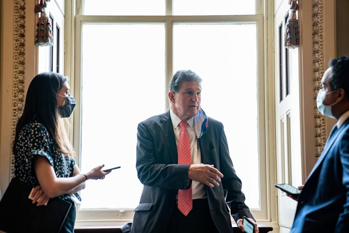 Sen. Joe Manchin (D-W.Va.) speaks to reporters at the Capitol in Washington, March 24, 2021. (Anna Moneymaker/The New York Times)