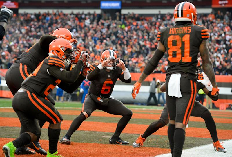 CLEVELAND, OH - DECEMBER 23, 2018: Quarterback Baker Mayfield #6 of the Cleveland Browns celebrates a touchdown pass to wide receiver Rashard Higgins in the third quarter of a game against the Cincinnati Bengals on December 23, 2018 at FirstEnergy Stadium in Cleveland, Ohio. Cleveland won 26-18. (Photo by: 2018 Nick Cammett/Diamond Images/Getty Images)