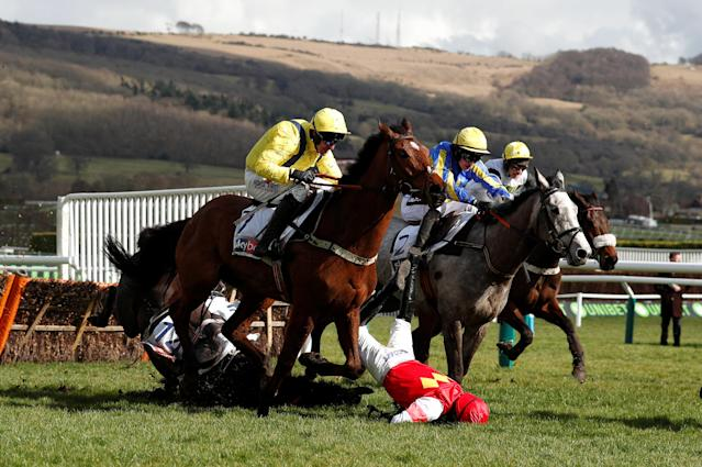 Horse Racing - Cheltenham Festival - Cheltenham Racecourse, Cheltenham, Britain - March 13, 2018 Harry Cobden falls off Slate House during the 13:30 Sky Bet Supreme Novices' Hurdle Action Images via Reuters/Andrew Boyers