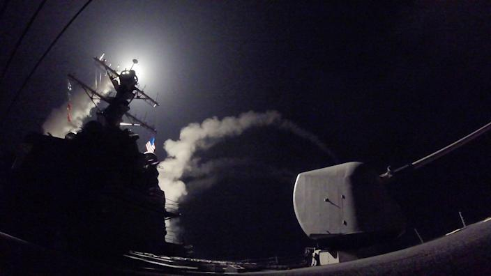 <p>The USS Porter fires a Tomahawk missile at a Syrian air base on April 7, 2017. (U.S. Navy via AP) </p>