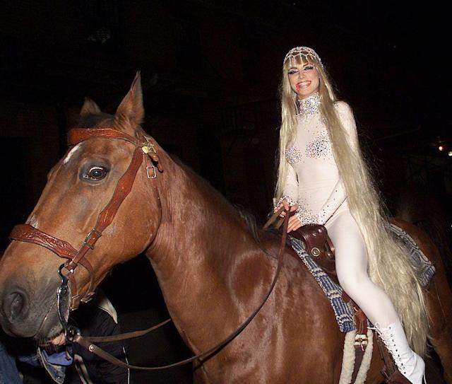 <p>No. 5: This was a game-changer! As the famously nude Lady Godiva, Klum arrived at her 2001 party in a long platinum wig and made quite an entrance — on horseback. While the costume was fairly simple, her showstopping arrival was a move that really upped the ante and demonstrated that she was serious about becoming the Halloween queen. She's been ruling the night ever since! (Photo: Evan Agostini/Getty Images) </p>