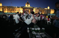 England fans celebrate in the fan zone of Trafalgar Square after England scored during the Euro 2020 soccer championship semifinal match between England and Denmark at Wembley Stadium in London, Wednesday, July 7, 2021, (AP Photo/Matt Dunham)