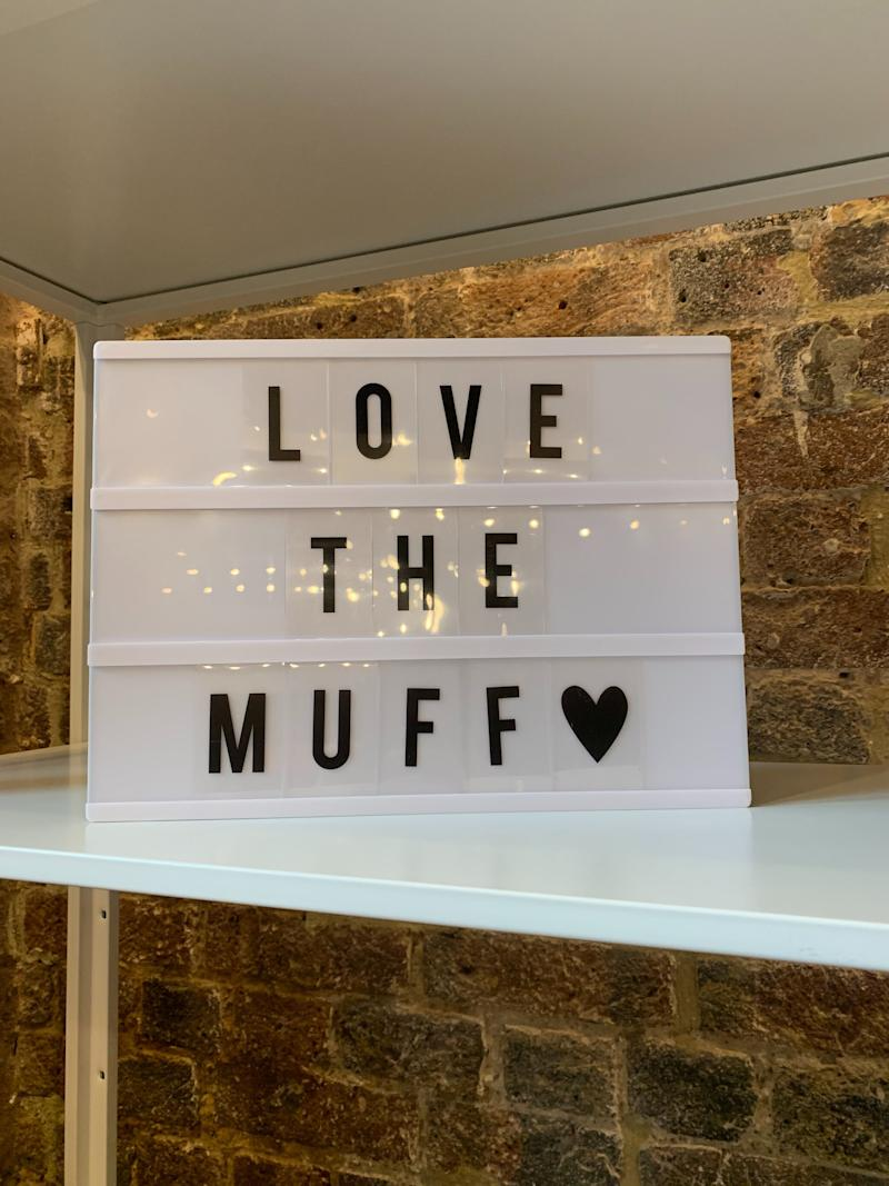A lightbox at the Vagina Museum with the words 'Love the Muff'