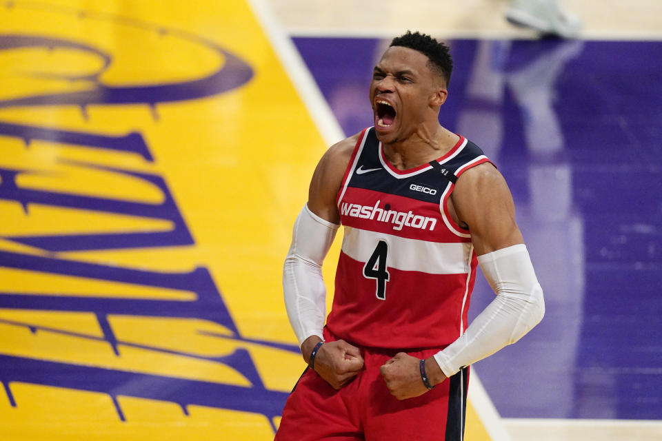 Washington Wizards guard Russell Westbrook celebrates after scoring and drawing a foul in the closing second of overtime in an NBA basketball game against the Los Angeles Lakers Monday, Feb. 22, 2021, in Los Angeles. The Wizards won 127-124 in overtime. (AP Photo/Mark J. Terrill)
