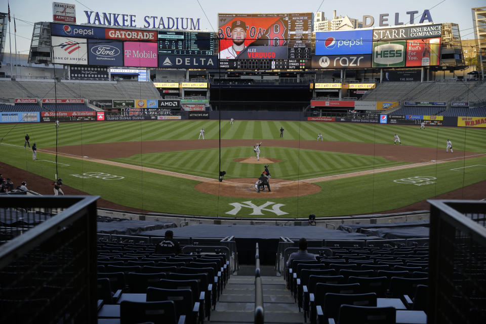 The stadium is almost totally empty during the second inning of a baseball game between the New York Yankees and the Boston Red Sox at Yankee Stadium, Friday, July 31, 2020, in New York. (AP Photo/Seth Wenig)
