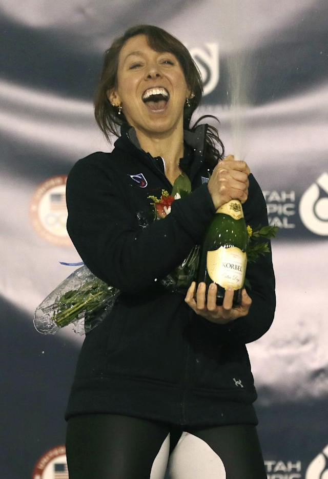 Jilleanne Rookard celebrates on the medals podium after winning the women's 3,000-meter during the U.S. Olympic speedskating trials on Friday, Dec. 27, 2013, in Kearns, Utah. (AP Photo/Rick Bowmer)