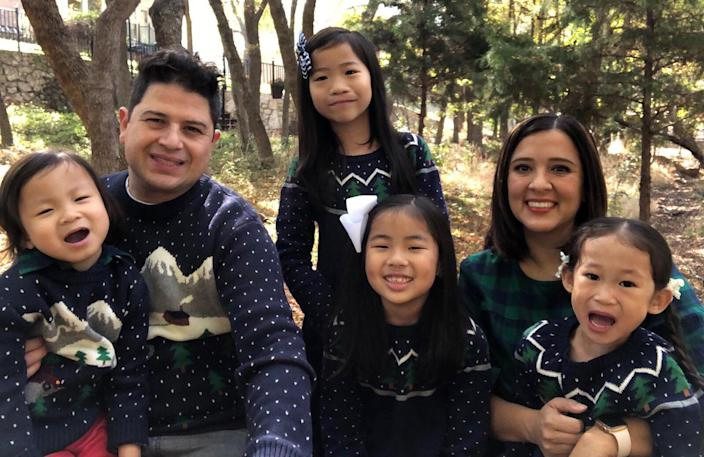 Isabel Márquez, seen with her husband and their four children. Because masks are not required in schools this year, and their two youngest children are in kidney failure, it felt too risky to send any of their kids to school. (Courtesy Isabel Márquez)