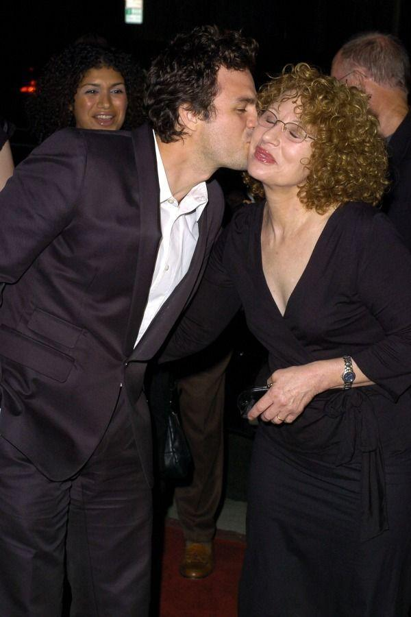 <p>Awww! Mark puckers up for his mom, Marie Rose, at the 2004 premiere of <em>Eternal Sunshine of the Spotless Mind</em>.</p>