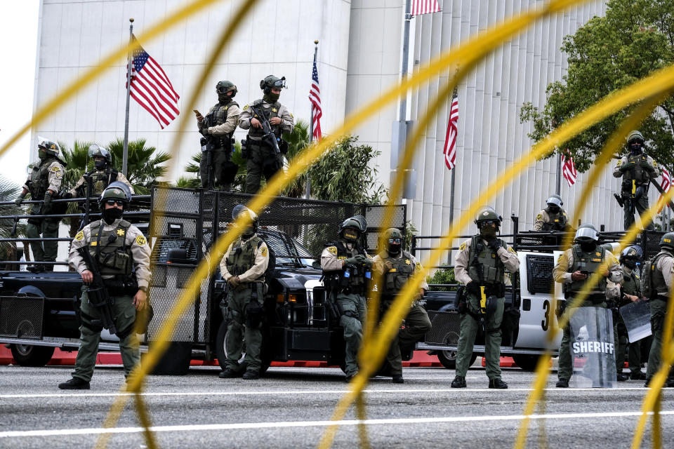 Police officers stand guard during in a protest outside the Federal Building against Israel and in support of Palestinians during the current conflict in the Middle East, Saturday, May 15, 2021, in the Westwood section of Los Angeles. (AP Photo/Ringo H.W. Chiu)