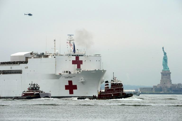 The USNS Comfort medical ship moves up the Hudson River past the Statue of Liberty as it arrives on March 30, 2020 in New York
