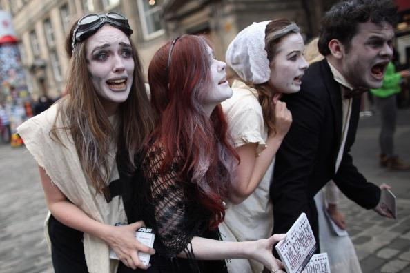 Street entertainers perform on the Royal Mile to promote their shows during in the Edinburgh Fringe Festival on August 6, 2012 in Edinburgh, Scotland. The Edinburgh Festival Fringe is the largest arts festivals in the world, it was established as an alternative to the International Festival also held in August, and celebrates it's 66th anniversary this year. (Photo by Dan Kitwood/Getty Images)