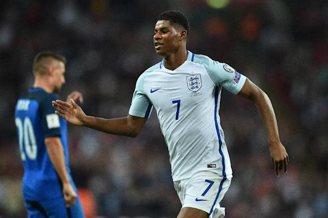 England's striker Marcus Rashford celebrates scoring England's second goal during the World Cup 2018 qualification football match against Slovakia at Wembley Stadium in London on September 4, 2017 (AFP Photo/Glyn KIRK )