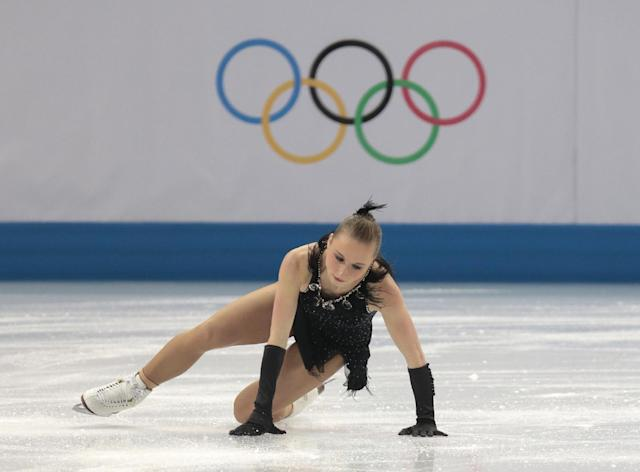 Nathalie Weinzierl of Germany falls as she competes in the women's team short program figure skating competition at the Iceberg Skating Palace during the 2014 Winter Olympics, Saturday, Feb. 8, 2014, in Sochi, Russia. (AP Photo/Ivan Sekretarev)