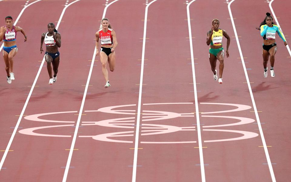 Asher-Smith, second left, started well in the women's 100m semi-final but struggled to keep pace as she neared the finishing line - PA