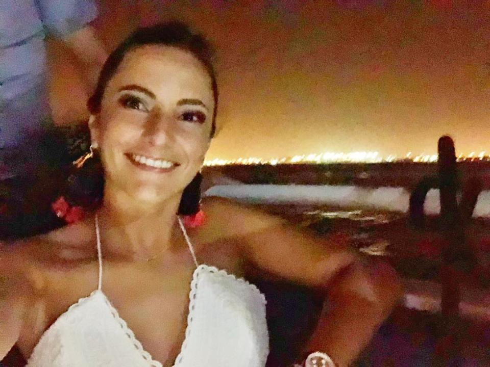 Pictured is Alejandra Jaramillo taking a selfie on a balcony. She made a life-changing decision during Melbourne's coronavirus lockdown.