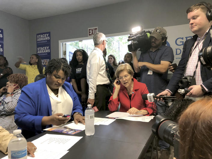 Georgia Democratic gubernatorial candidate Stacey Abrams, left, and Sen. Elizabeth Warren, a Democrat, right, call voters on Tuesday to rally support for Abrams in Jonesboro, Ga. (Photo: Ben Nadler/AP)