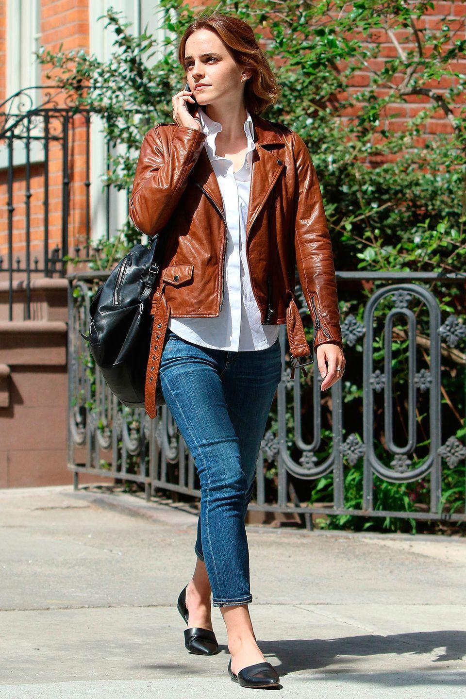 <p>A leather jacket is fashion's best friend this season. Take your cue from Emma Watson and opt for a shade of brown for a less harsh, less wintery finish.</p>