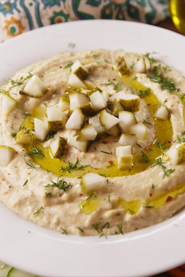 """<p>This hummus uses pickle brine in the most genius way.</p><p>Get the recipe from <a href=""""https://www.delish.com/cooking/recipe-ideas/recipes/a54831/dill-pickle-hummus-recipe/"""" rel=""""nofollow noopener"""" target=""""_blank"""" data-ylk=""""slk:Delish"""" class=""""link rapid-noclick-resp"""">Delish</a>.</p>"""