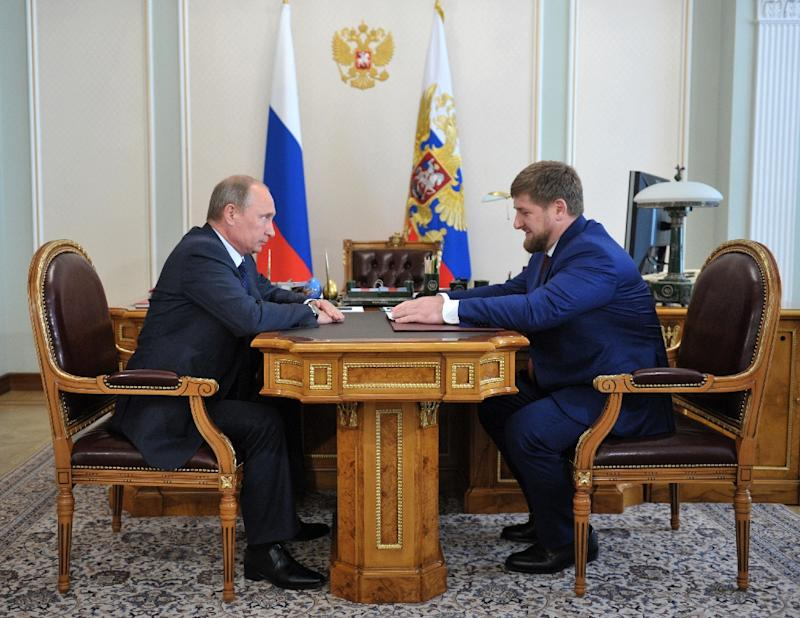 Russian President Vladimir Putin (L) speaks with Chechen leader Ramzan Kadyrov at the Novo-Ogaryovo residence outside Moscow on August 7, 2013