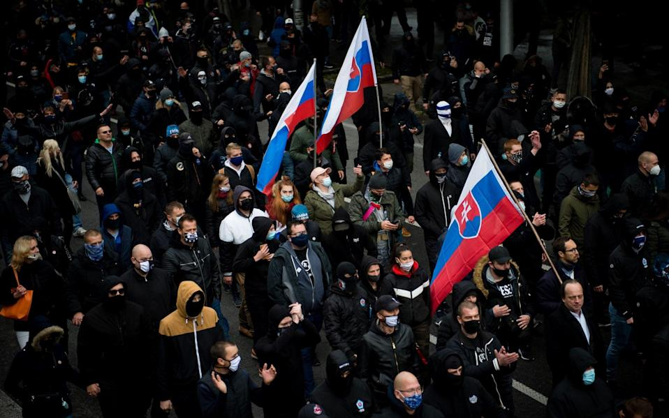 Hundreds of football hooligans and far-right supporters protest the government's precautionary measures - VLADIMIR SIMICEK/AFP via Getty Images