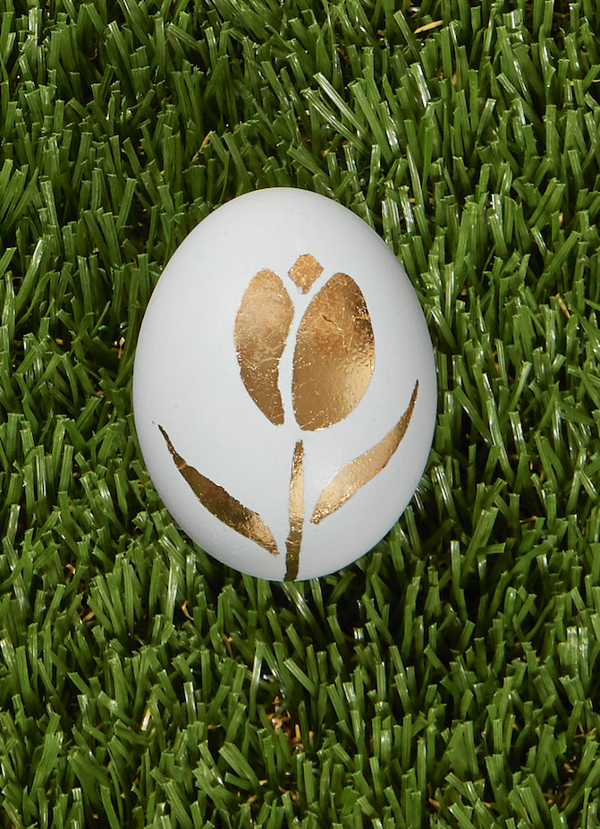 "<p>Draw a tulip on a natural egg to recreate this inspired decoration idea. Next, paint the inside of the drawing with Mod Podge, and allow it to sit until it's tacky. Finally, lay a sheet of gold leaf over drawing; use a soft brush to press onto glue. Once adhered, carefully brush away the excess foil.</p><p><a class=""link rapid-noclick-resp"" href=""https://www.amazon.com/Premium-Golden-Routine-Decoration-Accessories/dp/B07NQ86QZ2?tag=syn-yahoo-20&ascsubtag=%5Bartid%7C10050.g.1282%5Bsrc%7Cyahoo-us"" rel=""nofollow noopener"" target=""_blank"" data-ylk=""slk:SHOP GOLD LEAF"">SHOP GOLD LEAF</a></p>"