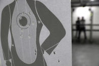 A target is perforated with bullet holes at the Valparaiso Shooting Club on the outskirts of Brasilia, Brazil, Thursday, March 4, 2021. Former national public security secretary Jose Vicente da Silva believes the presidential decrees on loosening gun control favor a small elite that can afford weapons without giving much back to a country where hundreds of policemen die each year and thousands are reportedly killed by gun violence. (AP Photo/Eraldo Peres)