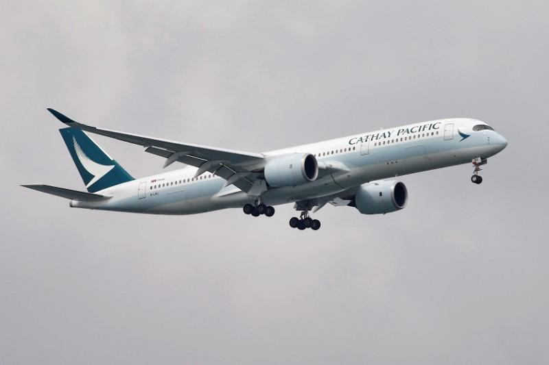A Cathay Pacific Airways Airbus A350 airplane approaches to land at Changi International Airport in Singapore