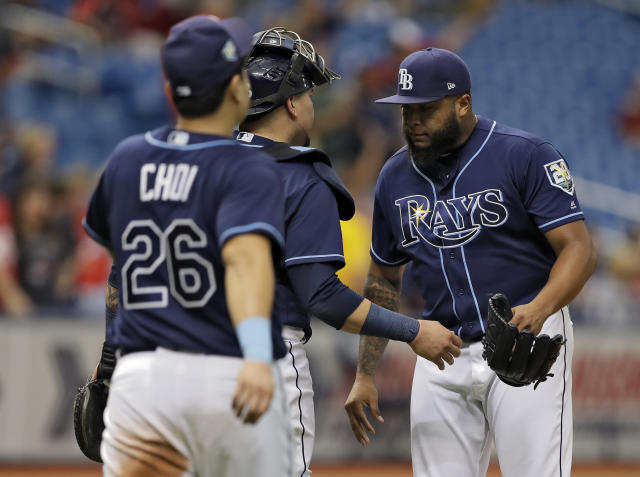 Tampa Bay Rays pitcher Jose Alvarado, right, celebrates with Jesus Sucre and Ji-Man Choi, of South Korea, right, after the Rays defeated the Cleveland Indians 3-1 during a baseball game Wednesday, Sept. 12, 2018, in St. Petersburg, Fla. (AP Photo/Chris O'Meara)