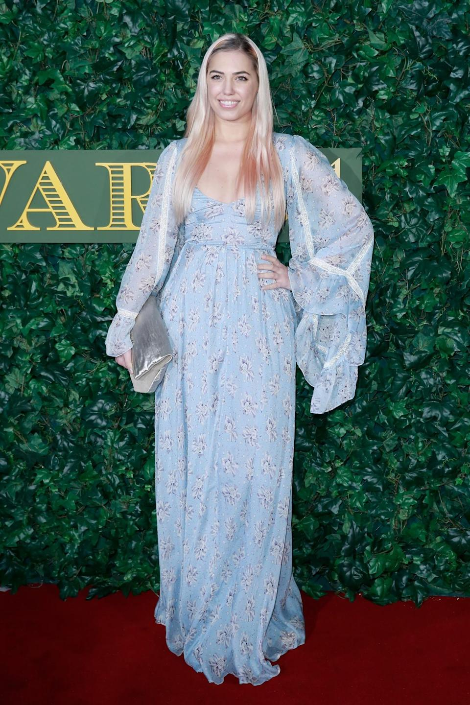 <p>Amber's usual impeccable taste was missing on this occasion when she chose a fairytale blue gown that swamped with its huge sleeves. <i>[Photo: Getty]</i> </p>
