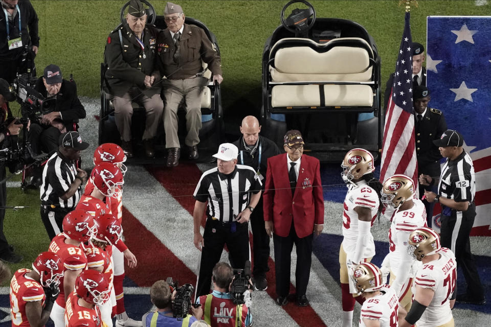 Armed Forces veterans participate during the coin toss before the NFL Super Bowl 54 football game Sunday, Feb. 2, 2020, in Miami Gardens, Fla. (AP Photo/Morry Gash)