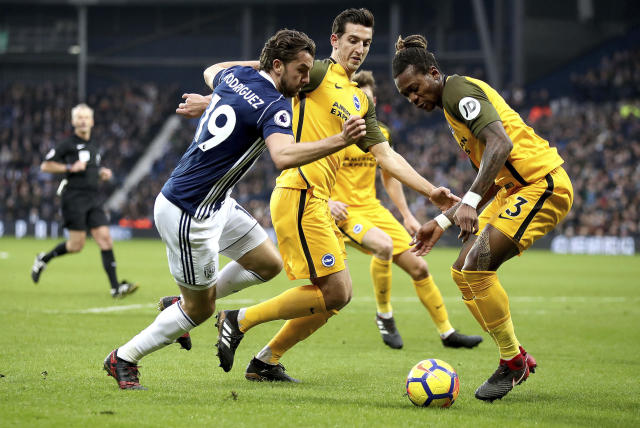 West Bromwich Albion's Jay Rodriguez, left, battles for the ball with Brighton & Hove Albion's Lewis Dunk and Gaetan Bong, right, during the English Premier League soccer match against Brighton at The Hawthorns, West Bromwich, England, Saturday Jan. 13, 2018. (Nick Potts/PA via AP)