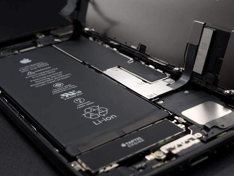 Chiangrai, Thailand: May 19, 2017 - Close-up image of Apple iPhone 7 jet black color disassembled for repair and showing components inside on black background. Selective focus