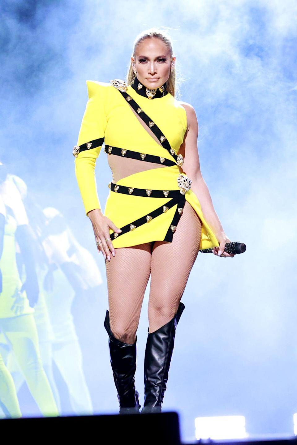 <p>Fausto Puglisi, the new creative director at Roberto Cavalli, worked with J Lo's team to design her this yellow cutout studded minidress for the event and also dress her backup dancers.</p>