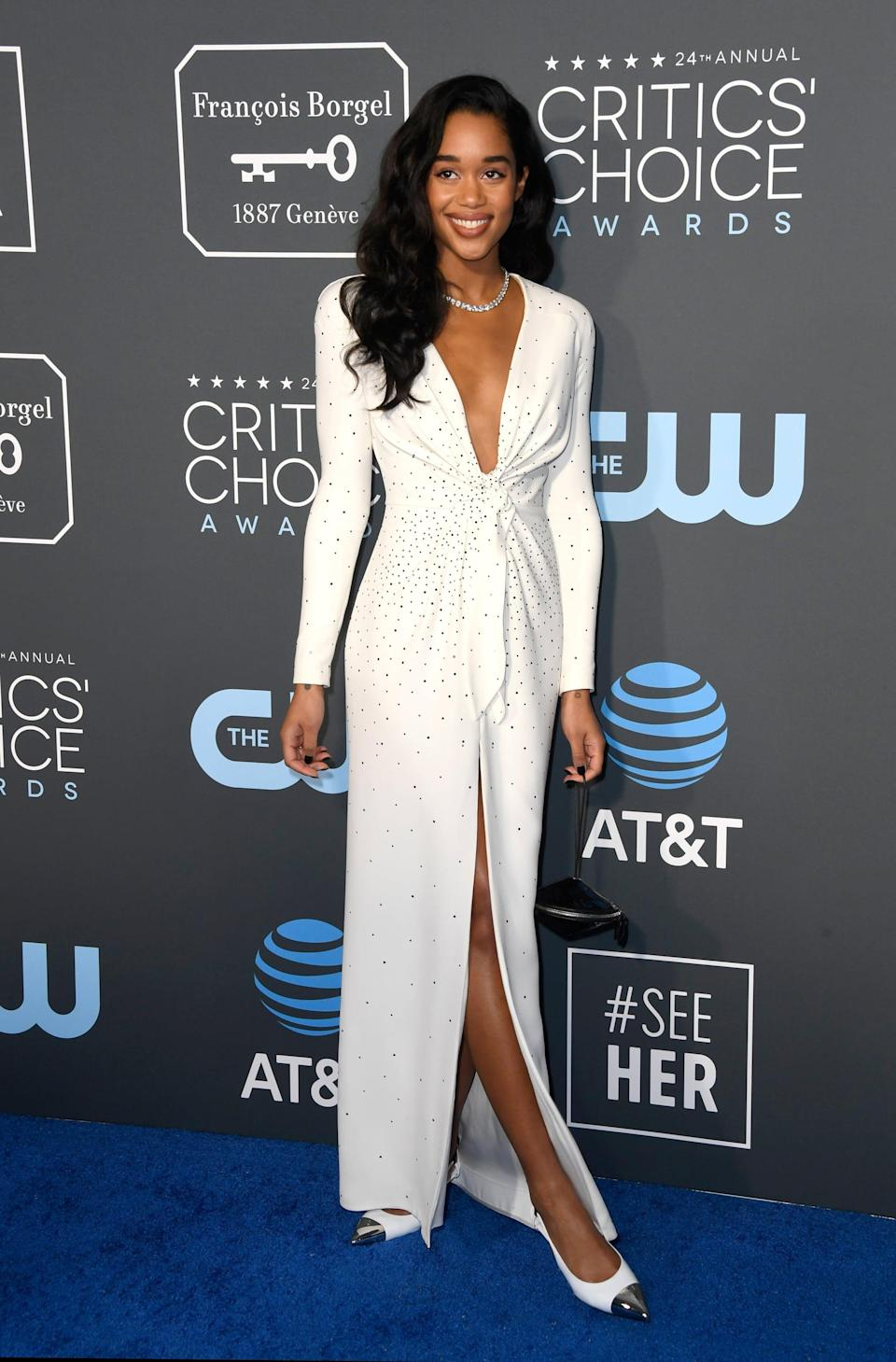 <p>Laura Harrier wearing a white Louis Vuitton gown with matching heels and Bulgari jewels.</p>
