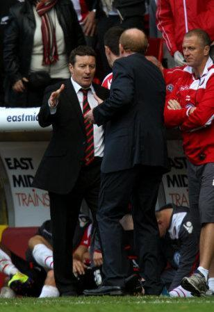 Sheffield United's manager Danny Wilson and Sheffield Wednesday's manager Gary Megson shake hands at the final whistle