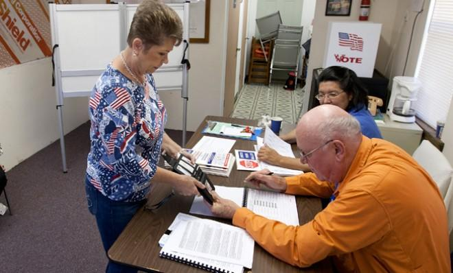 A poll worker checks a voter's identification ahead of the presidential election last November.