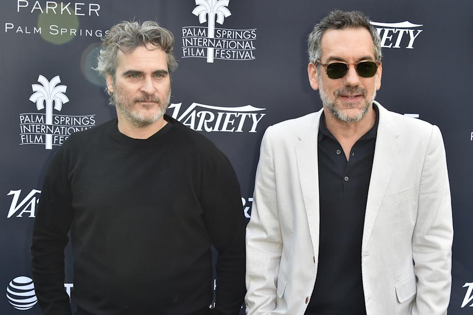 Todd Phillips (R), pictured here with Joaquin Phoenix, defended The Joker against backlash for its violence. (Photo by David Crotty/Patrick McMullan via Getty Images)