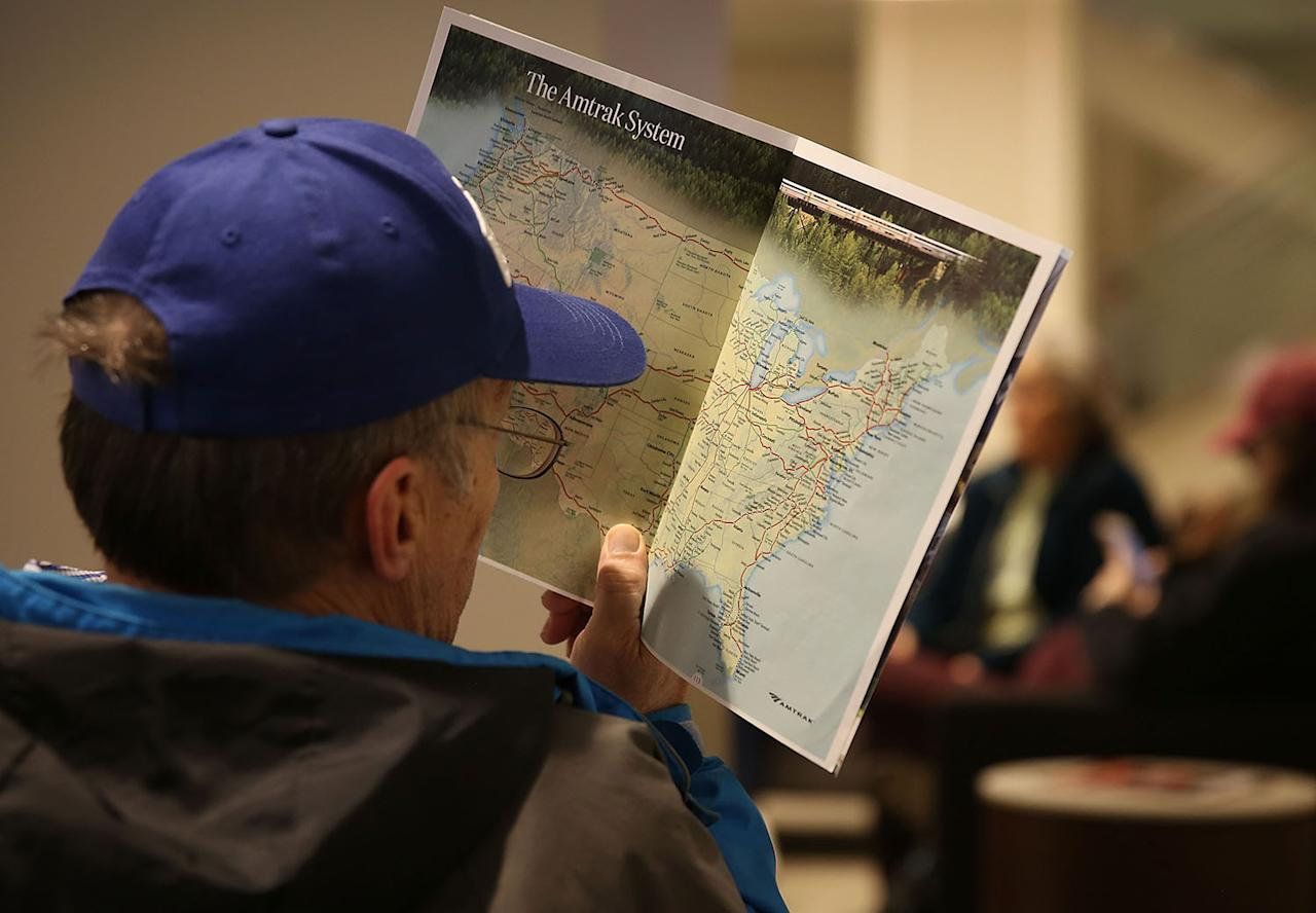 <p>A passenger looks at the Amtrak system map while waiting at Union station, where Amtrak's California Zephyr makes a daily 2,438 miles run to Emeryville/San Francisco, March 23, 2017 in Chicago. (Photo: Joe Raedle/Getty Images) </p>