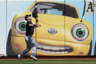 Seattle Mariners left fielder Dylan Moore catches a fly out hit by Oakland Athletics Tony Kemp during the fourth inning of a baseball game in Oakland, Calif., Tuesday, Aug. 24, 2021. (AP Photo/Jeff Chiu)