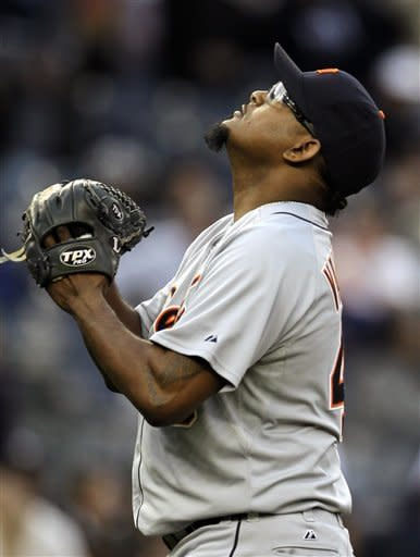 Detroit Tigers relief pitcher Jose Valverde reacts after getting New York Yankees' Eric Chavez to fly out to end the game during the night inning of a baseball game, Saturday, April 28, 2012, in New York. The Tigers won 7-5. (AP Photo/Julio Cortez)