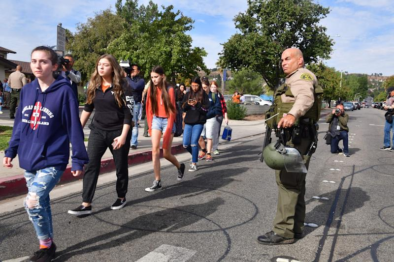 Students line up after a shooting at Saugus High School in Santa Clarita, California on Nov. 14, 2019. (Photo: Frederic J. Brown/AFP via Getty Images)