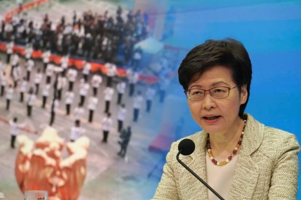 Hong Kong Chief Executive Carrie Lam attends a news conference on the Hong Kong electoral system reform in Hong Kong on Tuesday. China's top legislature approved amendments to Hong Kong's constitution on Tuesday giving Beijing more control over the make-up of the city's legislature.