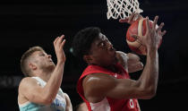 Japan's Rui Hachimura (8), right, grabs a rebound in front of Slovenia's Edo Muric (8) during men's basketball preliminary round game at the 2020 Summer Olympics, Thursday, July 29, 2021, in Saitama, Japan. (AP Photo/Eric Gay)