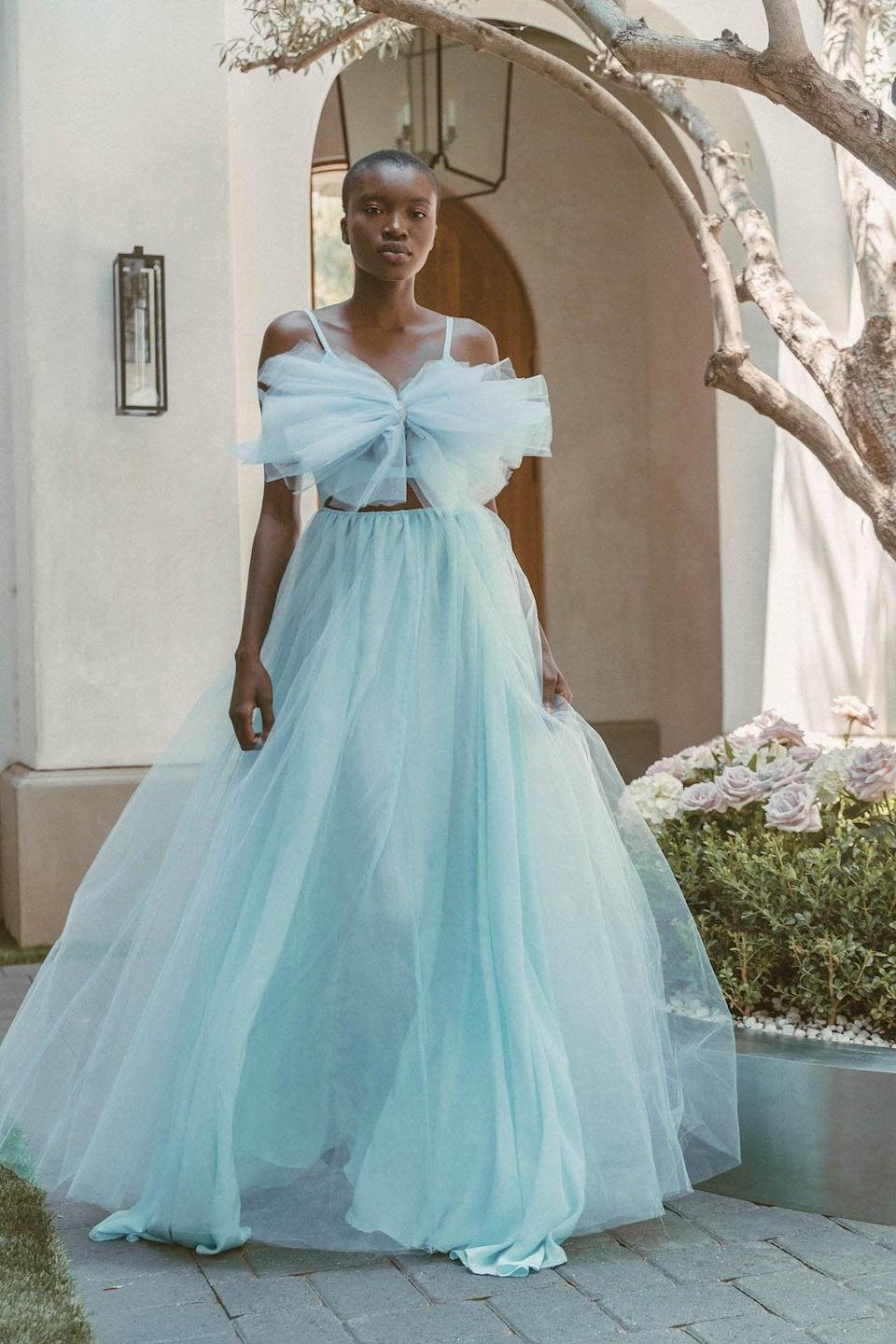 """<p>Dare to be different and wear """"something blue!"""" This <a href=""""https://www.popsugar.com/buy/Lurelly-Juniper-Tulle-Gown-582284?p_name=Lurelly%20Juniper%20Tulle%20Gown&retailer=lurelly.com&pid=582284&price=900&evar1=fab%3Aus&evar9=47551973&evar98=https%3A%2F%2Fwww.popsugar.com%2Fphoto-gallery%2F47551973%2Fimage%2F47552337%2FLurelly-Juniper-Tulle-Gown&list1=shopping%2Cwedding%2Cbride%2Cwedding%20dresses%2Cfashion%20shopping%2Cbest%20of%202020&prop13=api&pdata=1"""" class=""""link rapid-noclick-resp"""" rel=""""nofollow noopener"""" target=""""_blank"""" data-ylk=""""slk:Lurelly Juniper Tulle Gown"""">Lurelly Juniper Tulle Gown</a> ($900) is amazing.</p>"""