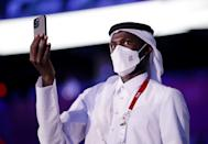 <p>An athlete from Team Qatar is seen during the Opening Ceremony of the Tokyo 2020 Olympic Games. (Photo by Hannah McKay - Pool/Getty Images)</p>