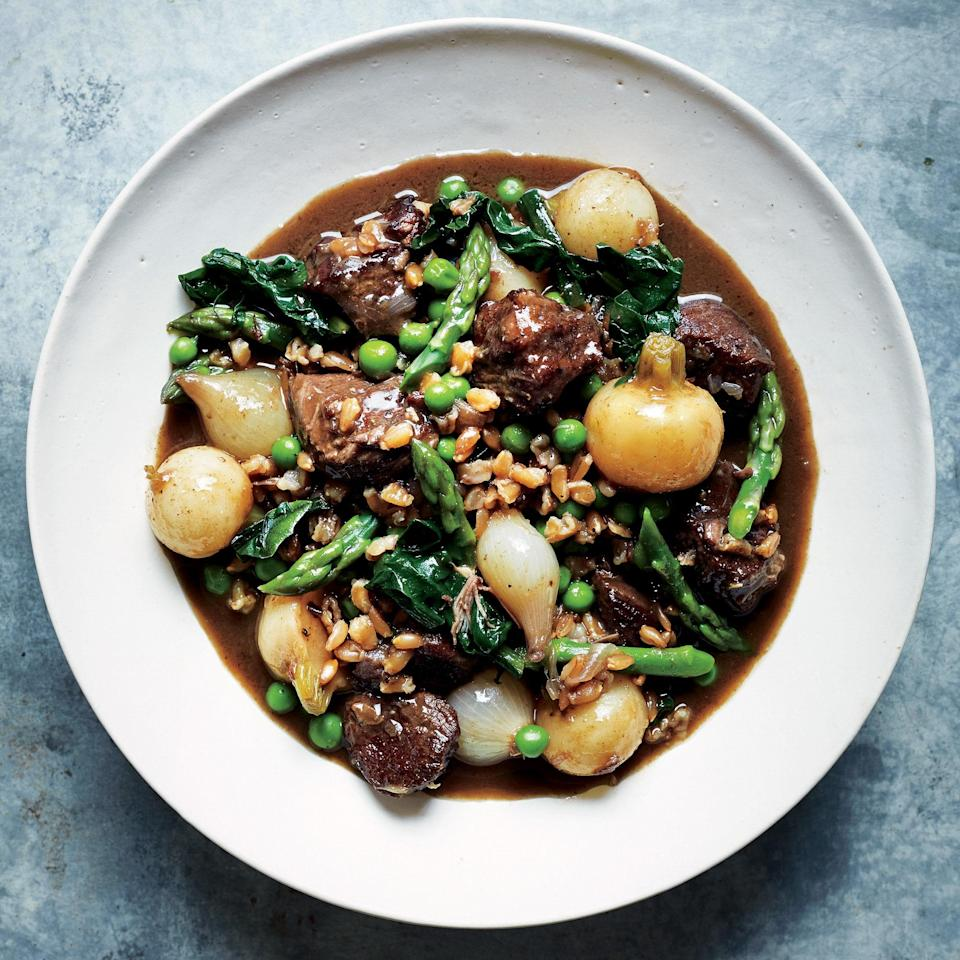 """This elegant stew can be made up to the point that the farro goes in; cool, then cover and chill up to 2 days. <a href=""""https://www.epicurious.com/recipes/food/views/ragout-of-lamb-and-spring-vegetables-with-farro-56389406?mbid=synd_yahoo_rss"""" rel=""""nofollow noopener"""" target=""""_blank"""" data-ylk=""""slk:See recipe."""" class=""""link rapid-noclick-resp"""">See recipe.</a>"""