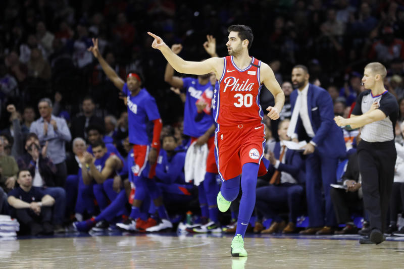 Philadelphia's Furkan Korkmaz had one more teammate than usual to thank for a 3-pointer. (AP Photo/Matt Slocum)